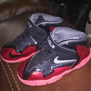 Red nike boy shoes